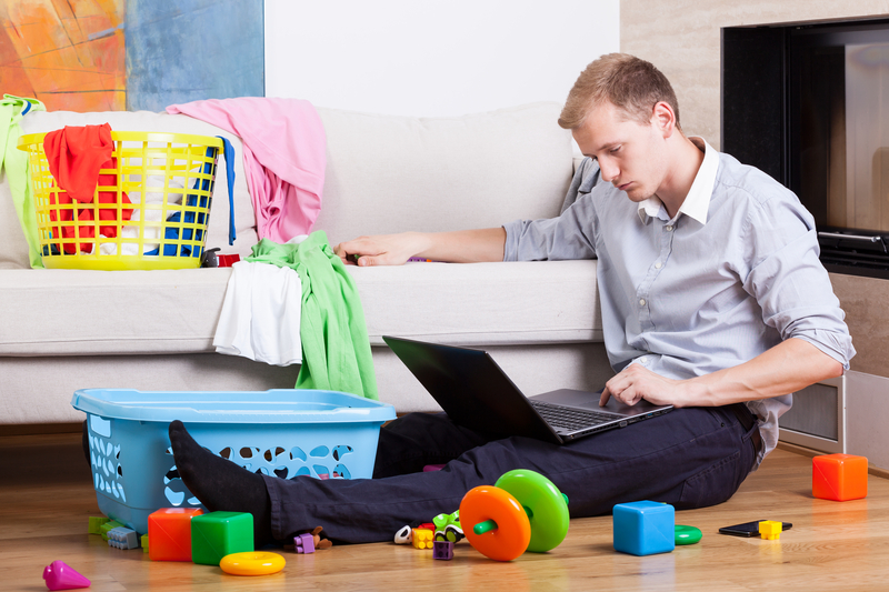 © Bialasiewicz | Dreamstime.com - Sleepy Father Trying To Work Photo